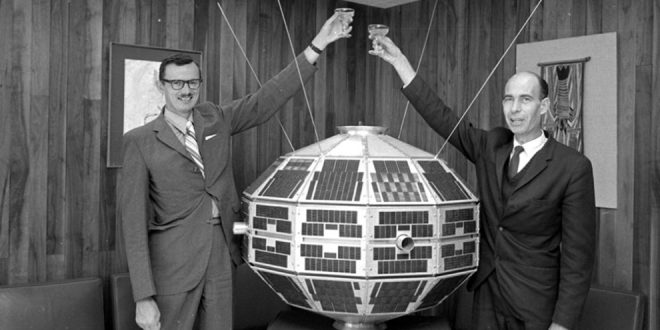 Dr. John Chapman (L) and Dr. LeRoy Nelms (R) toast the success of the Alouette satellite