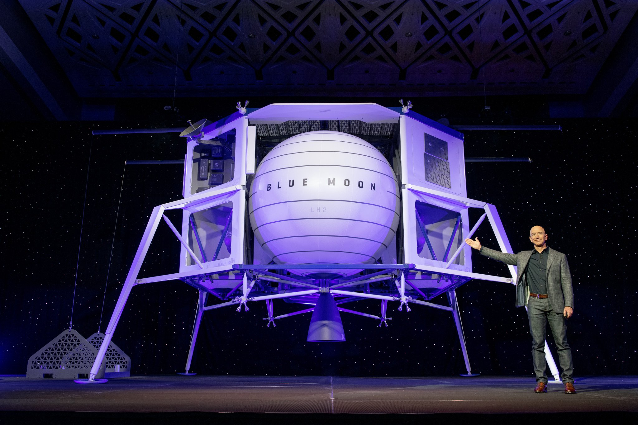 Jeff Bezos next to the Blue Moon lunar lander