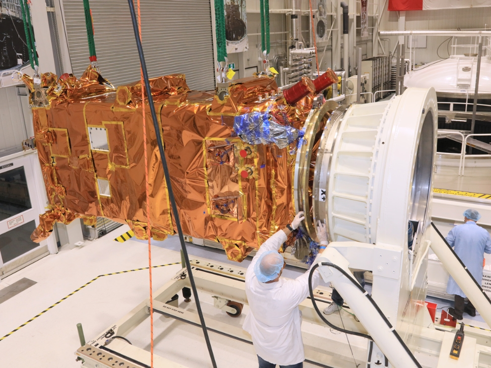 The third RCM spacecraft is about to be inserted in a thermal vacuum chamber for testing at the David Florida Laboratory.