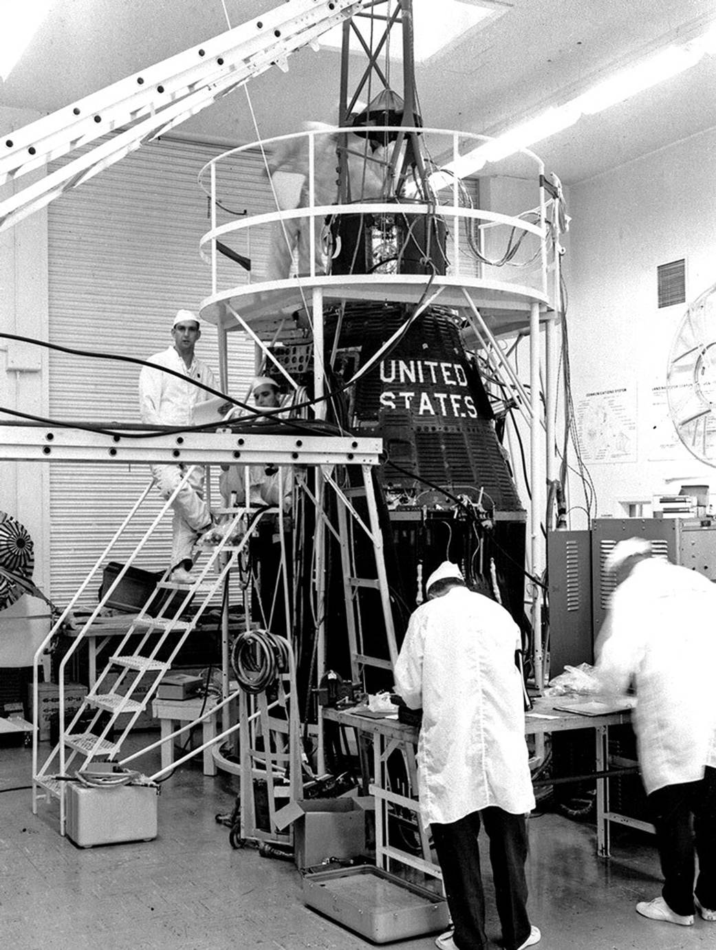 The Mercury Capsule for the Mercury Atlas 7 mission of NASA astronaut Scott Carpenter undergoes testing in the White Room of Hangar S on April 11, 1962. Credit: NASA.