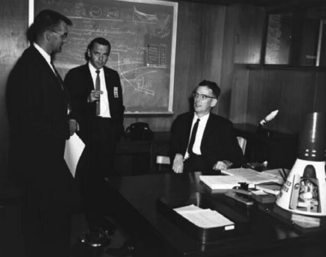 Jim Chamberlin with with Andre J. Meyer, Jr., and Paul M. Sturtevant in his office at the Manned Spacecraft Center (later renamed Johnson Space Center) in Houston, Texas, in 1962. Credit: NASA.