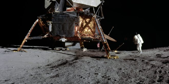 View of Apollo 12 lunar surface photos with lunar module pilot Alan L. Bean and the TV taken from just inside the rim of Surveyor Crater on the first moonwalk of the mission. The panoramas were built by combining Apollo 12 images