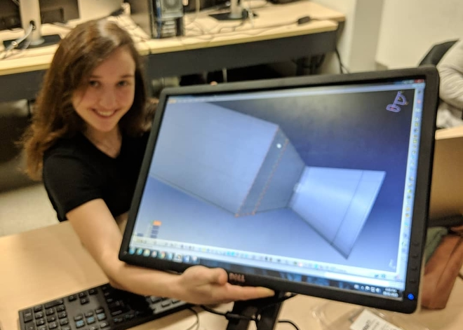 "From the RPG Facebook group: ""Our Nozzle Design Engineer Antonella showcasing our final nozzle design!!! After 4 months of design work the #ryersonpropulsiongroup is working hard this week to document our Critical Design Report! Next up? purchasing and fabrication."" Credit: Ryerson Propulsion Group."