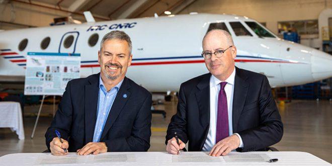 CSA President, Sylvain Laporte (left) and NRC President, Iain Stewart signing the memorandum of understanding