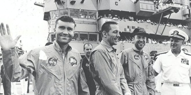 This photograph shows Apollo 13 astronauts Fred Haise, John Swigert, and James Lovell aboard the recovery ship, USS Iwo Jima after safely touching down in the Pacific Ocean at the end of their ill-fated mission. The mission was aborted after 56 hours of flight, 205,000 miles from Earth, when an oxygen tank in the service module exploded. The command module, Odyssey, brought the three astronauts back home safely