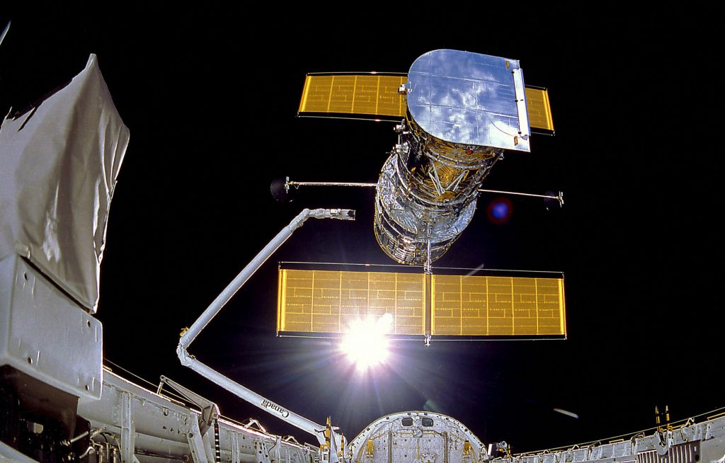 IMAX Cargo Bay Camera view of the Hubble Space Telescope at the moment of release, mission STS-31.