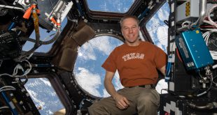 NASA astronaut Tim Kopra poses inside the cupola module onboard the International Space Station. Kopra, who was born in Austin, Texas, is the commander of Expedition 47 and previously served as a flight engineer during Expeditions 46 and 20