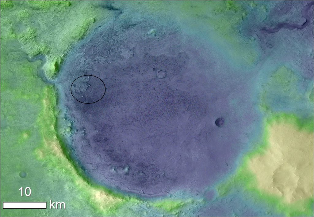 Lighter colors represent higher elevation in this image of Jezero Crater on Mars, the landing site for NASA's Mars 2020 mission. The oval indicates the landing ellipse, where the rover will be touching down on Mars. The color added to this image helps the crater rim stand out clearly, and makes it easier to spot the shoreline of a lake that dried up billions of years ago