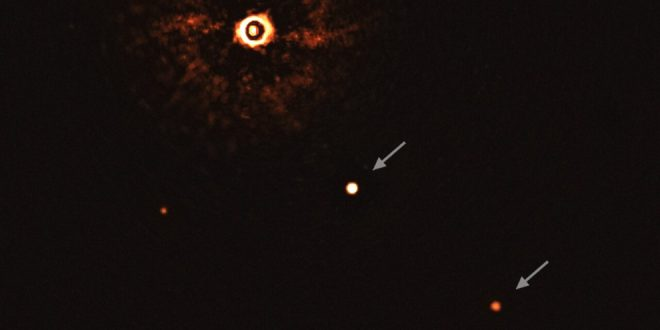 This image, captured by the SPHERE instrument on ESO's Very Large Telescope, shows the star TYC 8998-760-1 accompanied by two giant exoplanets, TYC 8998-760-1b and TYC 8998-760-1c. This is the first time astronomers have directly observed more than one planet orbiting a star similar to the Sun