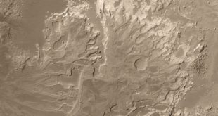 "This picture from NASA's Mars Global Surveyor could help settle a decades-long debate about whether the planet had long-lasting rivers instead of just brief, intense floods. The image of the delta-like fan shows eroded ancient deposits of transported sediment long since hardened into interweaving, curved ridges of layered rock. Scientists interpret some of the curves as traces of ancient ""meanders"" made in a sedimentary fan as flowing water changed its course over time"