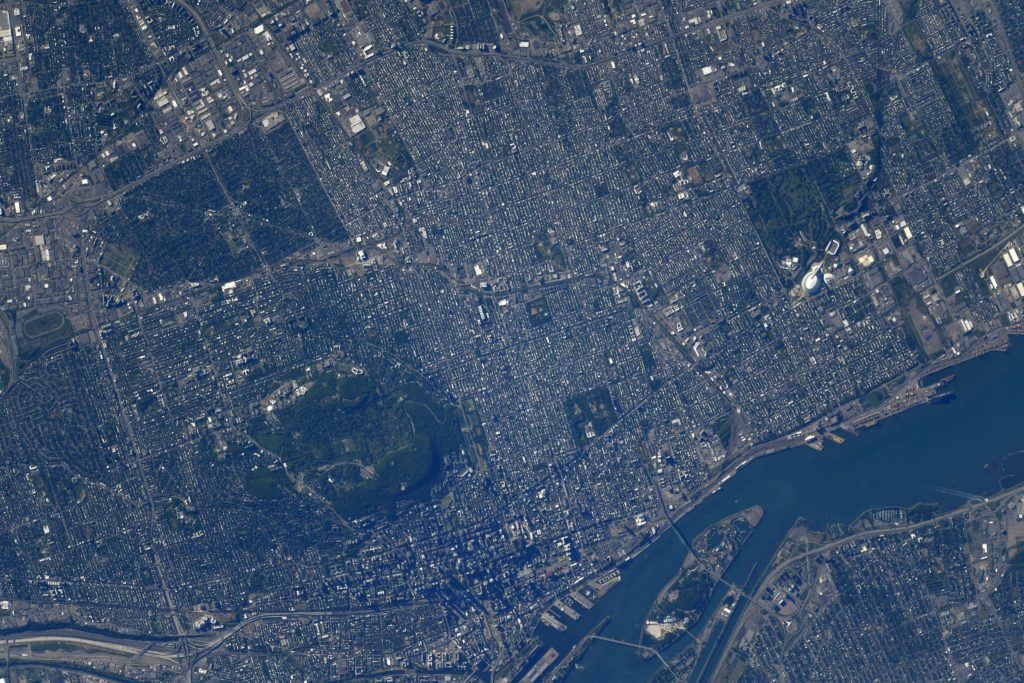Downtown Montreal with Mount Royal, and the Olympic Stadium. Credit: NASA.