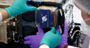 The SatRevolution's STORK-4 satellite with SkyWatch TerraStream onboard being inserted into its dispenser